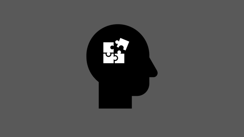 Head logo with thought puzzle pieces